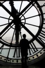 man-facing-clock-paris-349030_640